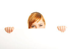 Large woman holding a white board Stock Photos