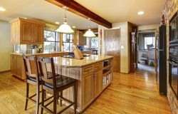 Large wood kitchen with hardwood floor. stock image