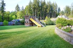 Large wood play ground for kids at back yard. Large wood play ground for kids at private home spring back ground Royalty Free Stock Photo