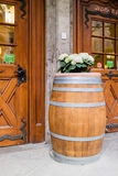 Large wooden barrell with flowers on top Stock Photos