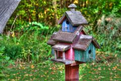 Large wooden Bird House on a 4x4 in High Dynamic Range. Home made wooden bird house on a pole in High Dynamic Range stock photos