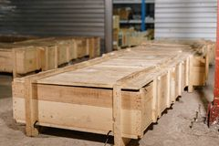 Large wooden boxes. Warehouse of spare parts for machines and mechanisms. Production of ventilation and drainpipe royalty free stock image
