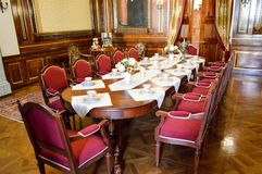 A large wooden brown old antique table for celebrations, feasts, stock photography