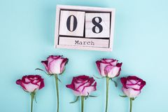 Large wooden calendar and roses. Old calendar and five roses. My heart belongs to you royalty free stock images
