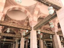 Large wooden ceiling beams, planks, ceilings under the ceiling with arches and lamps, lanterns in the Arab Islamic Mosque, a templ stock images