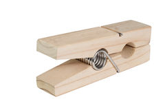 Large wooden clothespin. Isolated over white Royalty Free Stock Images