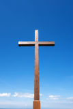 Large wooden cross on the Plettenberg. Large cross made of oak wood against blue sky, taken on the Plettenberg, Swabian Alps, Germany stock image