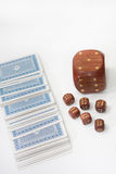 Large wooden dice with a small wooden dices and a deck of cards Royalty Free Stock Image