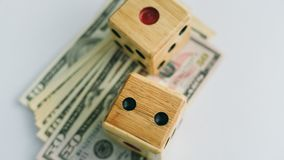 Dice and Dollar in gambling stock image