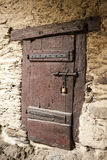 A large wooden door closed an old fortress in the stone wall of the castle in Germany on the Rhine River Royalty Free Stock Images