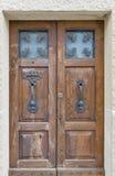 Large wooden door with metal handle and decoration, San Marino Stock Photos