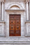 Large wooden door white marble church Stock Images