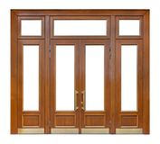 Wooden entrance with cutout windows and double door with long gilded knobs, isolated on white background design element,. Large wooden entrance with cutout royalty free stock photography
