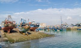 Large wooden fishing boats anchored on dry dock in port of medieval town Essaouira, Morocco, North Africa Stock Photo
