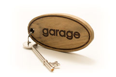 Large Wooden Garage Key Fob and Key. Large Wooden Garage Key Fob with a large metal key attached Royalty Free Stock Photos