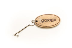 Large Wooden Garage Key Fob and Key. Large Wooden Garage Key Fob with a large metal key attached Royalty Free Stock Images