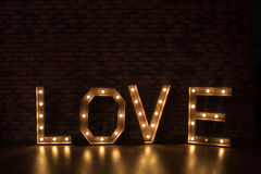 Large wooden illuminated letters LOVE Royalty Free Stock Photography