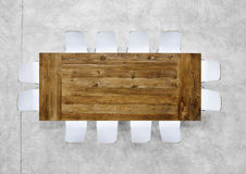 Large Wooden Meeting Table with Twelve Chairs Royalty Free Stock Photography