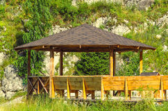 Large wooden pavilion in the forest stock image