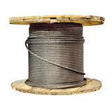 Large wooden reel with a cargo of steel rope. Stock Photography