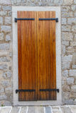 Large wooden shutters in a stone wall Stock Images