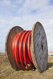 Large wooden spool with heavy underground cable Royalty Free Stock Photos
