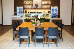 Large wooden table in a cafe royalty free stock photo