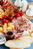 Large wooden table meat, bread and vegetables Royalty Free Stock Photo