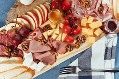 Large wooden table meat, bread and vegetables Royalty Free Stock Photography