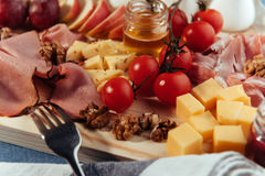 Large wooden table meat, bread and vegetables Stock Photos