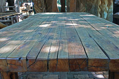 LARGE WOODEN TABLE IN SHADE Stock Photography