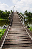 Large wooden walking bridge over a canal Stock Photos