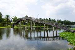 Large wooden walking bridge over a canal Stock Images