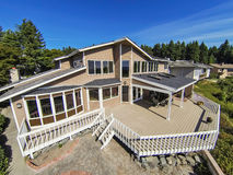 Large wooden walkout deck of luxury suburban house Royalty Free Stock Photo