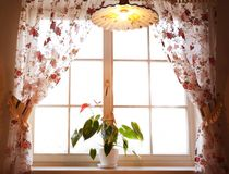 Large wooden window with beautiful curtains. In sunny day Stock Images