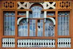 Large wooden window. Composed of hundreds of small frames made ​​in disrepair Royalty Free Stock Photo
