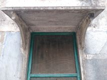 Large wooden window and stone gazebo, Rajasthan. royalty free stock image