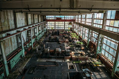 Large workshop in an abandoned factory, abandoned industrial concept. Large old workshop in an abandoned factory, abandoned industrial concept, toned Royalty Free Stock Images
