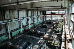 Large workshop in an abandoned factory, abandoned industrial concept. Toned Royalty Free Stock Image