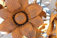 Large wrought iron rusted flower. Large round wrought iron rusted flower petals brown closeup made by hand stock image