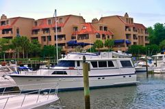 Luxury Yacht and Condominiums. Large yachts docked at the marina with condos in the background stock photo