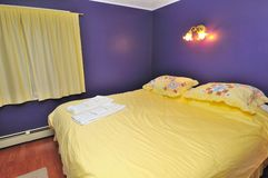 Large Yellow Bed Stock Photography