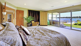 Large yellow bedroom with lake view and hot tub Royalty Free Stock Photo