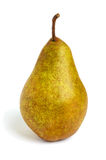 A large yellow brown pear  stands straight  isolated on a white background Royalty Free Stock Photos