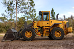Large yellow bulldozer. Side view of a yellow bulldozer at a construction site Royalty Free Stock Image
