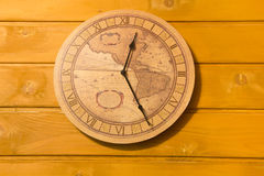 Large yellow clock on the wall Stock Image