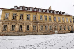 Large yellow cracked old school building. Big historic building with cracked facade in winter royalty free stock photography