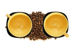 Large yellow cup and black saucer Royalty Free Stock Images