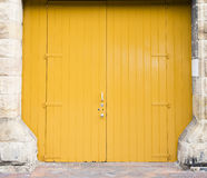 Large yellow double doors Stock Photos