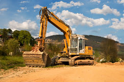 Large yellow excavator Stock Photography